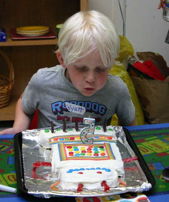 Wyatt blowing out his candles